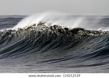 Long and high wave on the Portuguese coast - stock photo