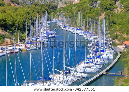 Long and narrow canal called calanque with many sail boats by the pier in Cassis, France - stock photo