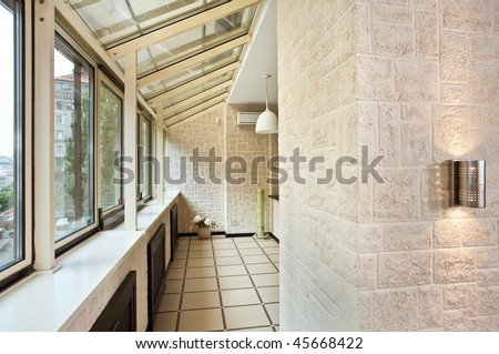 Long balcony (gallery) interior with pvc windows
