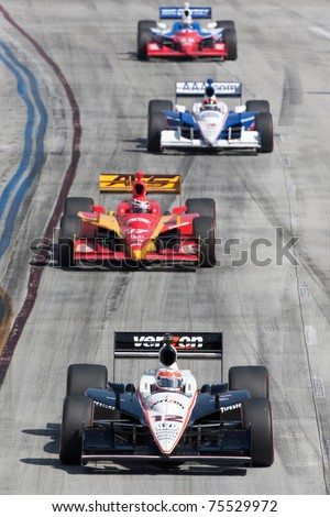 LONG BEACH, CA. - APR 17: Will Power in the #12 car leads a small chase group during the Toyota Grand Prix of Long Beach on April 17, 2011 in Long Beach, CA. - stock photo