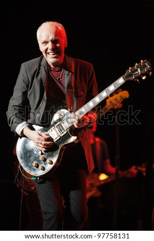 LONG BEACH, CA - MARCH 14: Peter Frampton played to a sold out crowd on March 14, 2012 at the Terrace Theatre in Long Beach, California. - stock photo