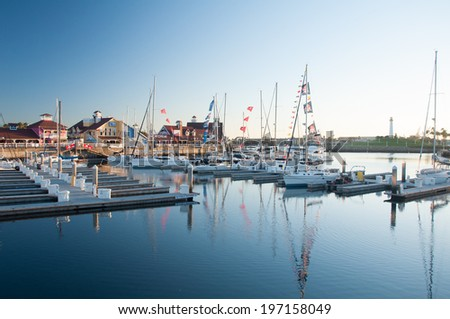 LONG BEACH, CA - SEPTEMBER 13, 2010: Yachts and boats in the harbor of Long Beach Marina next to the lighthouse and Queen Mary. September 13, 2010 in Long Beach Marina, United States