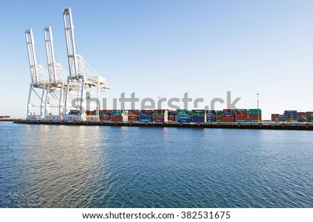 LONG BEACH/CALIFORNIA - FEB. 20, 2016: Long Beach Container Terminal cranes and containers. The 2nd busiest port in America. Long Beach, California USA