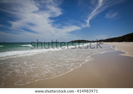 Long beach on Keppel Island, Queensland, Australia. Sun soaked sand beside turquoise ocean at the start of the Great Barrier Reef. - stock photo