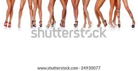 Long beautiful female legs, isolated on a white background, please see some of my other parts of a body images: - stock photo