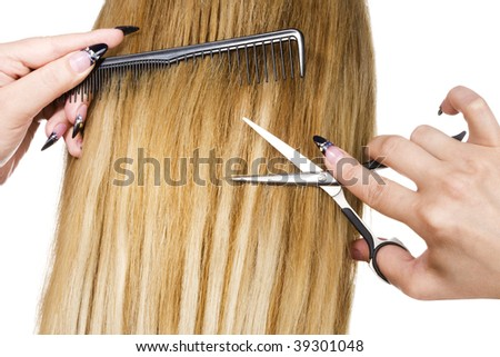Long blond hair and hairdresser tools