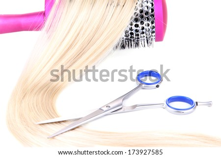 Long blond hair with hairbrush and scissors isolated on white - stock photo