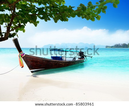 long boat and poda island in Thailand - stock photo