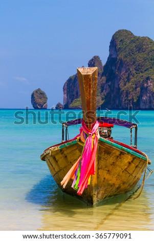 Long boat and tropical beach, Andaman Sea,Phi Phi Islands, Thailand - stock photo