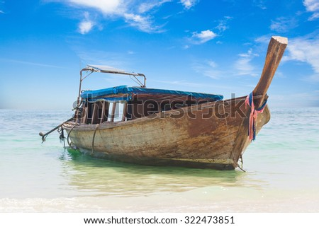 Long boat and tropical beach, Andaman Sea, Thailand - stock photo