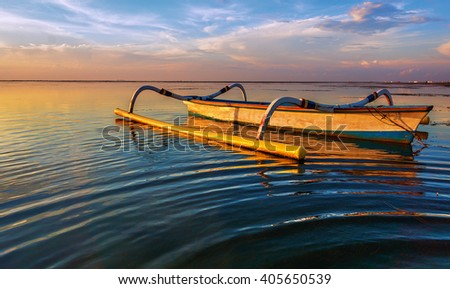Long Boat in Golden Hours During Sunrise At Karang Beach Sanur Bali Indonesia  - stock photo