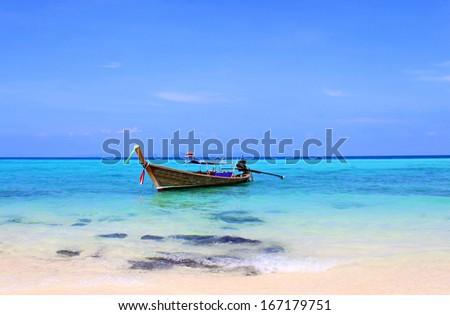 Long boat  near Bamboo Island, Koh Mai Pai, in Thailand - stock photo