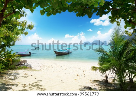 long boat on Phi Phi island in Thailand - stock photo