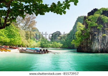 long boats on island in Thailand - stock photo