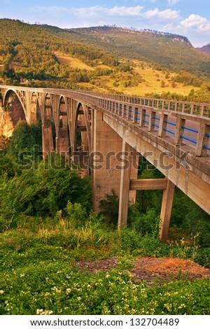 Long bridge over Tara river in Montenegro - stock photo