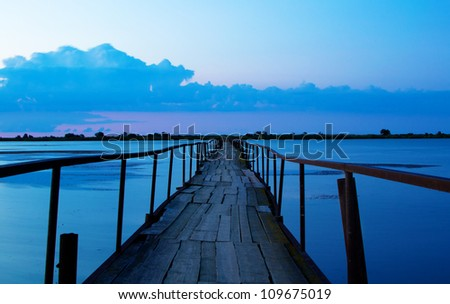 long bridge to clouds - stock photo