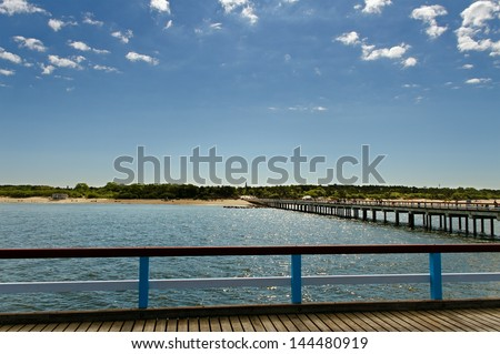 Long bridge to the sea in Palanga. - stock photo