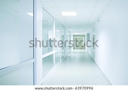 Long bright corridor in scientific laboratory building. - stock photo