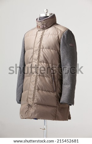 long brown down jacket isolate on gray background