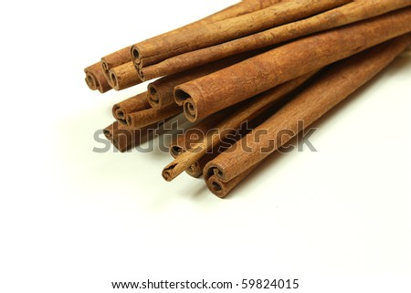 Long cinnamon sticks isolated over white