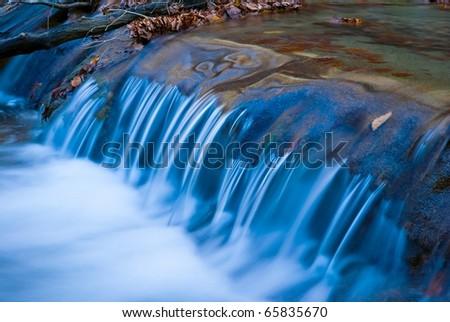 long closeup water cascade - stock photo