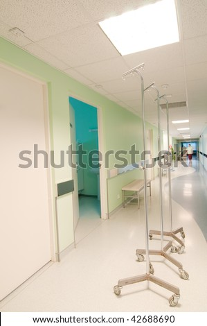 Long corridor in hospital with doors and reflections - stock photo