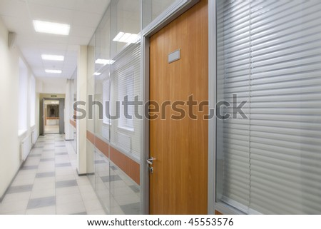 Long corridor in the business center - stock photo