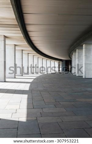 long corridor of a building with columns  - stock photo