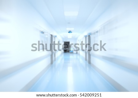 Long corridor of hospital building, defocused background.