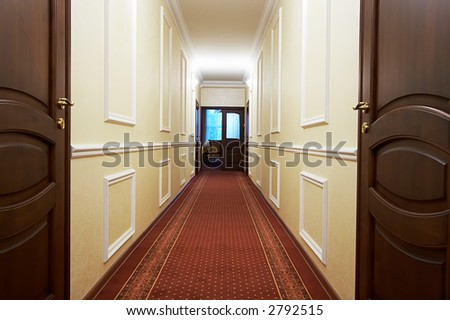 Long corridor with a window in modern hotel - stock photo