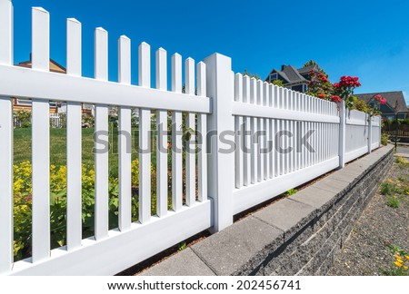 Long country style garden fence. - stock photo