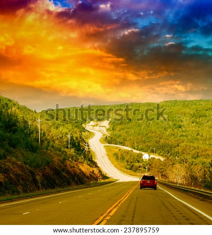 Long countryside road of Quebec, Canada. - stock photo