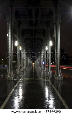 Long, dark alley at rainy night - stock photo