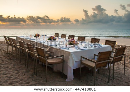 long dinner table on the beach at Thailand - stock photo