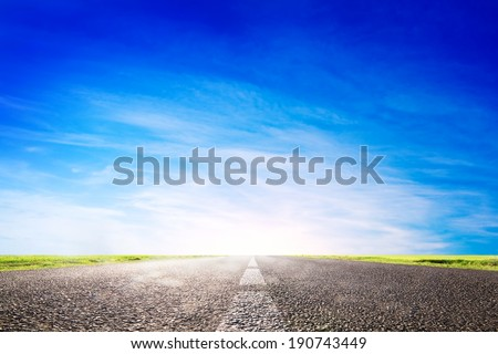Long empty asphalt road, highway towards sun. Travel, transport concepts - stock photo