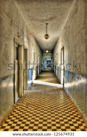 Long empty corridor and doors in an abandoned building