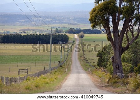 Long empty country road in Tasmania - stock photo