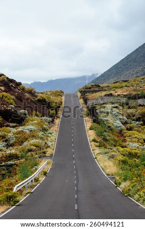 Long Empty Desert Asphalt Road in El Hierro Canary Islands Spain