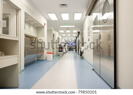 Long empty hospital corridor - stock photo