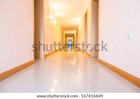 Long empty hotel hallway, corridor - stock photo