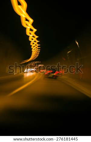 Long exposure abstract shot in a tunnel with moving cars. - stock photo