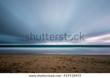 Long exposure at sunset looks like time travel, speed of light. - stock photo