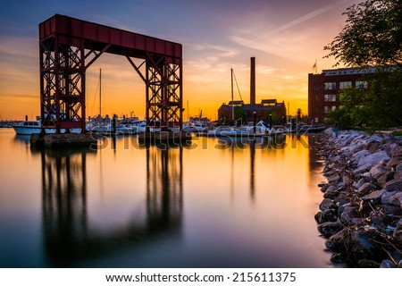 Long exposure at sunset on the waterfront in Canton, Baltimore, Maryland. - stock photo