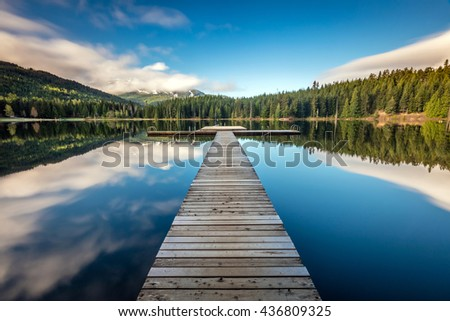 Long exposure at the Lost Lake dock in Whistler, British Columbia - stock photo