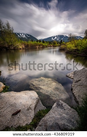 Long exposure at the river of golden dreams on a dark moody day in Whistler resort, British Columbia, Canada - stock photo