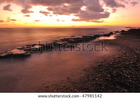 Long Exposure. Beach on sunset - stock photo