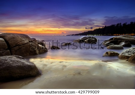 long exposure , Beautiful seascape sunset or sunrise at the sea with stone on Beautiful cloud scape moody sky at Rayong  , Thailand