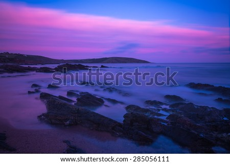 Long exposure bllured waves at beach, seascape at twilight - stock photo