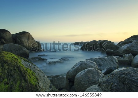 Long exposure by the sea. - stock photo