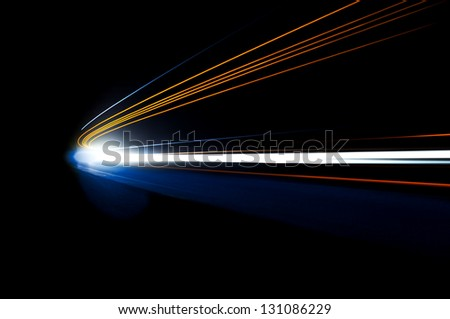 Long exposure car light trails in road tunnel - stock photo